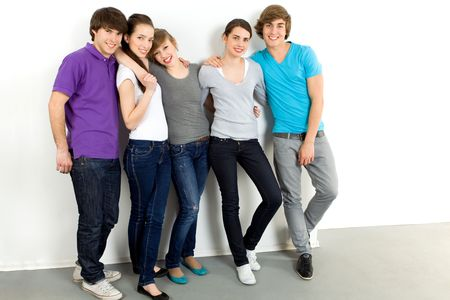 Five young friends standing together photo