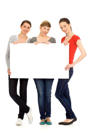 Three young girls holding blank sign photo