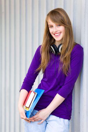 Female student holding books Stock Photo - 7172390