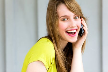 Girl with her mobile phone Stock Photo - 7172392