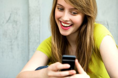mobile phone adult: Girl with her mobile phone Stock Photo