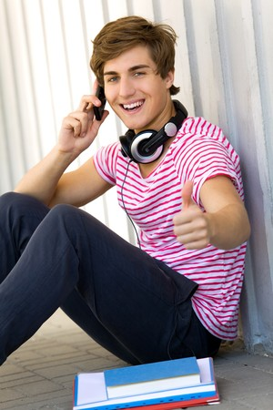 Male student with thumbs up Stock Photo - 7309095