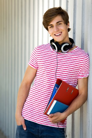 cool boy: Student holding books