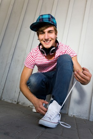 Teenager tying shoes Stock Photo - 7314973