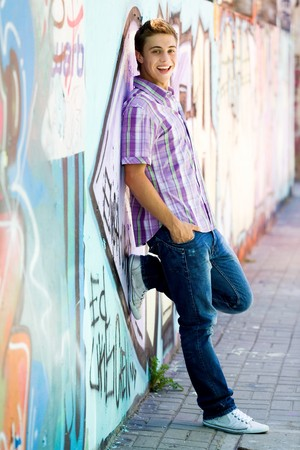 Young guy leaning on graffiti wall Stock Photo - 7367558