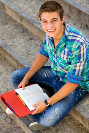 Student sitting on stairs Stock Photo - 7367564