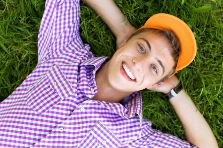 Young man lying down on grass Stock Photo - 7379942