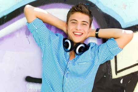 Young guy leaning on graffiti wall Stock Photo - 7379965