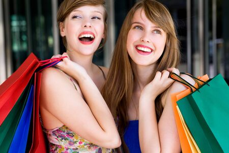 happy shopping: Young women with shopping bags Stock Photo