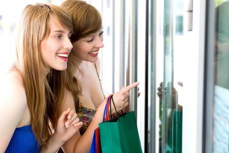 window shopper: Women looking in shop window
