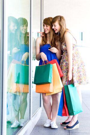 Women looking in shop window photo