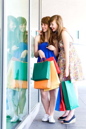 clothes shop: Women looking in shop window