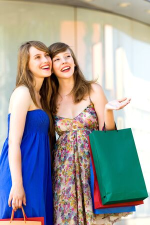 Friends shopping together photo