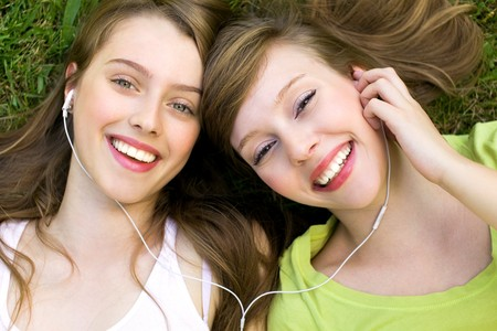 friendship: Girls with mp3 player