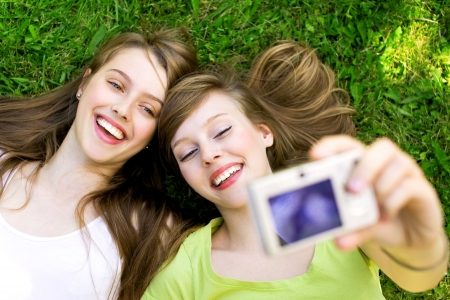 Two friends taking pictures photo