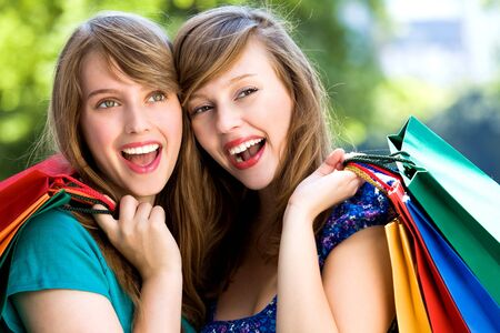 Girls with shopping bags photo