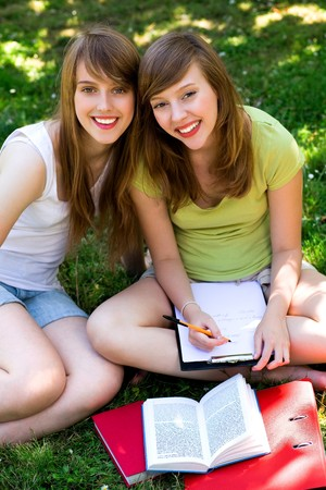 Two young women studying outdoors photo
