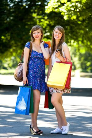 Happy young women with shopping bags Stock Photo - 7605336