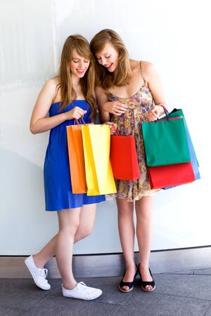 Women looking at shopping bags photo