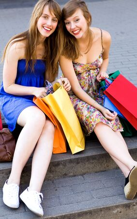 Two women with shopping bags Stock Photo - 7605342
