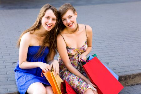 Two women with shopping bags photo