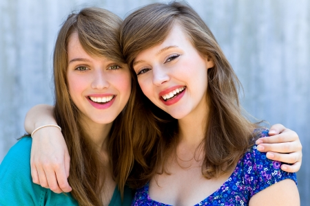 girl friends: Two friends hugging Stock Photo