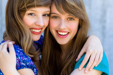 friends laughing: Two friends hugging Stock Photo