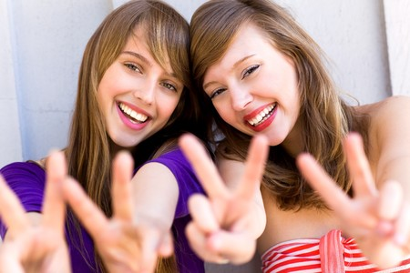 peace sign: Teenage girls making a peace sign