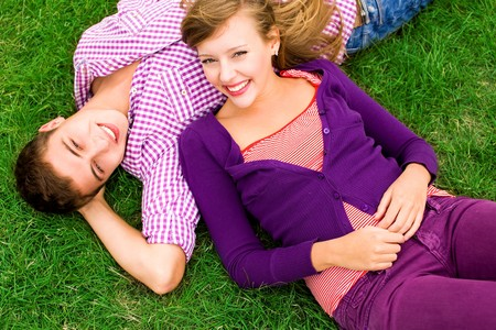 Couple lying down on grass Stock Photo - 7832656