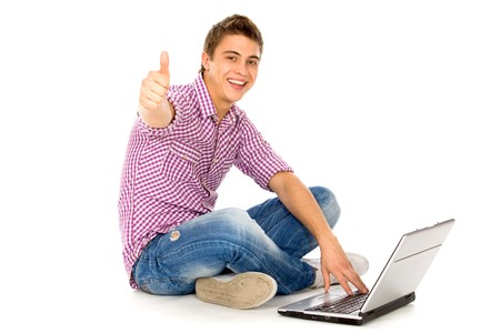 successful student: Young man sitting with laptop