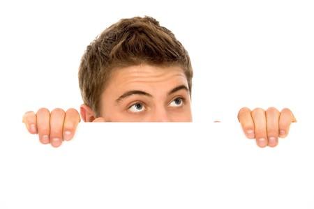 blank billboard: Mann peeping �ber eine leere billboard Lizenzfreie Bilder