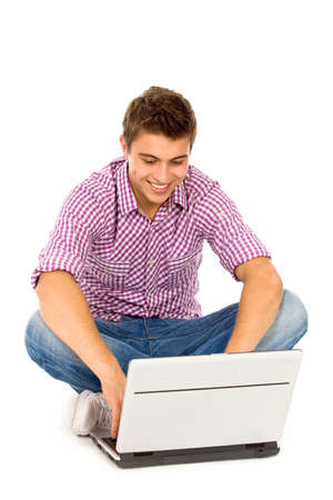 Young man using laptop Stock Photo - 8097034