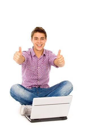 thumbs up gesture: Young man using laptop