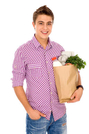 Young man with bag of groceries Stock Photo - 8097040