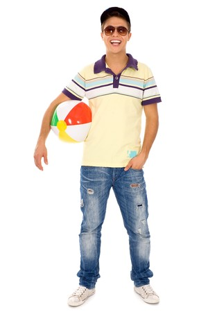Young man holding beach ball photo