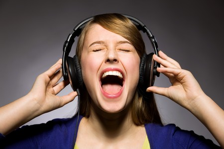 loud music: Girl listening to music Stock Photo