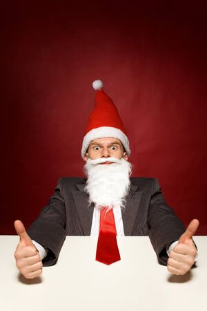 Funny santa showing thumbs up photo