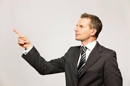 Businessman pointing photo