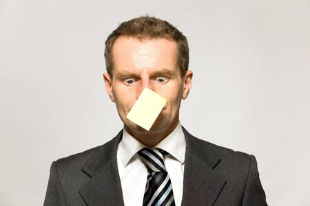 Businessman with paper on his nose photo