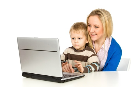 Mother and Son Using Laptop Stock Photo - 8735104