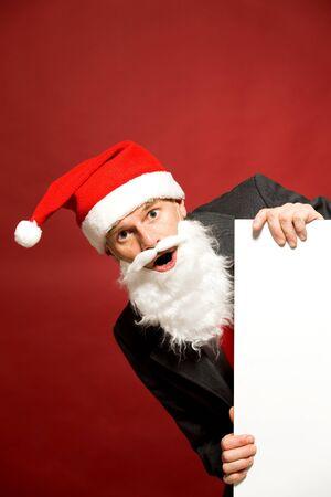Santa holding blank poster photo