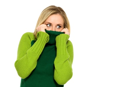 Woman pulling sweater over face photo