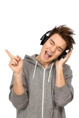 people listening: Young man enjoying music