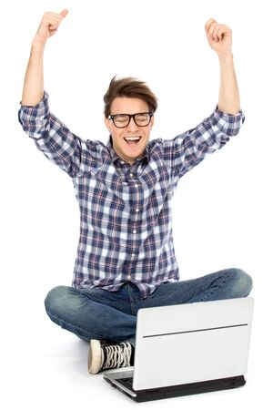 excited: Young man using laptop