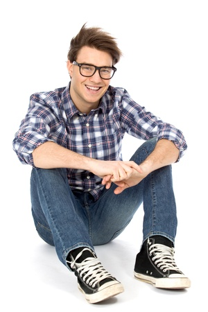 trendy: Young man sitting on floor Stock Photo