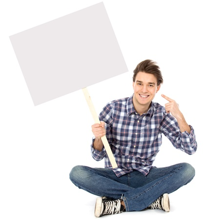 Young man holding blank poster Stock Photo - 8888106