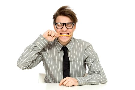 Businessman biting pen photo