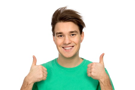 Casual young guy showing thumbs up Stock Photo - 8904601