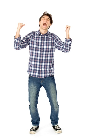 Young man clenching fists and shouting photo