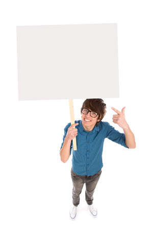 Young man holding blank poster photo